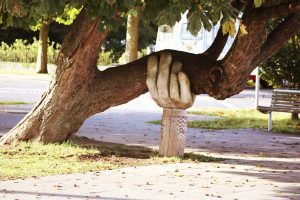 Carved hand supporting a tree